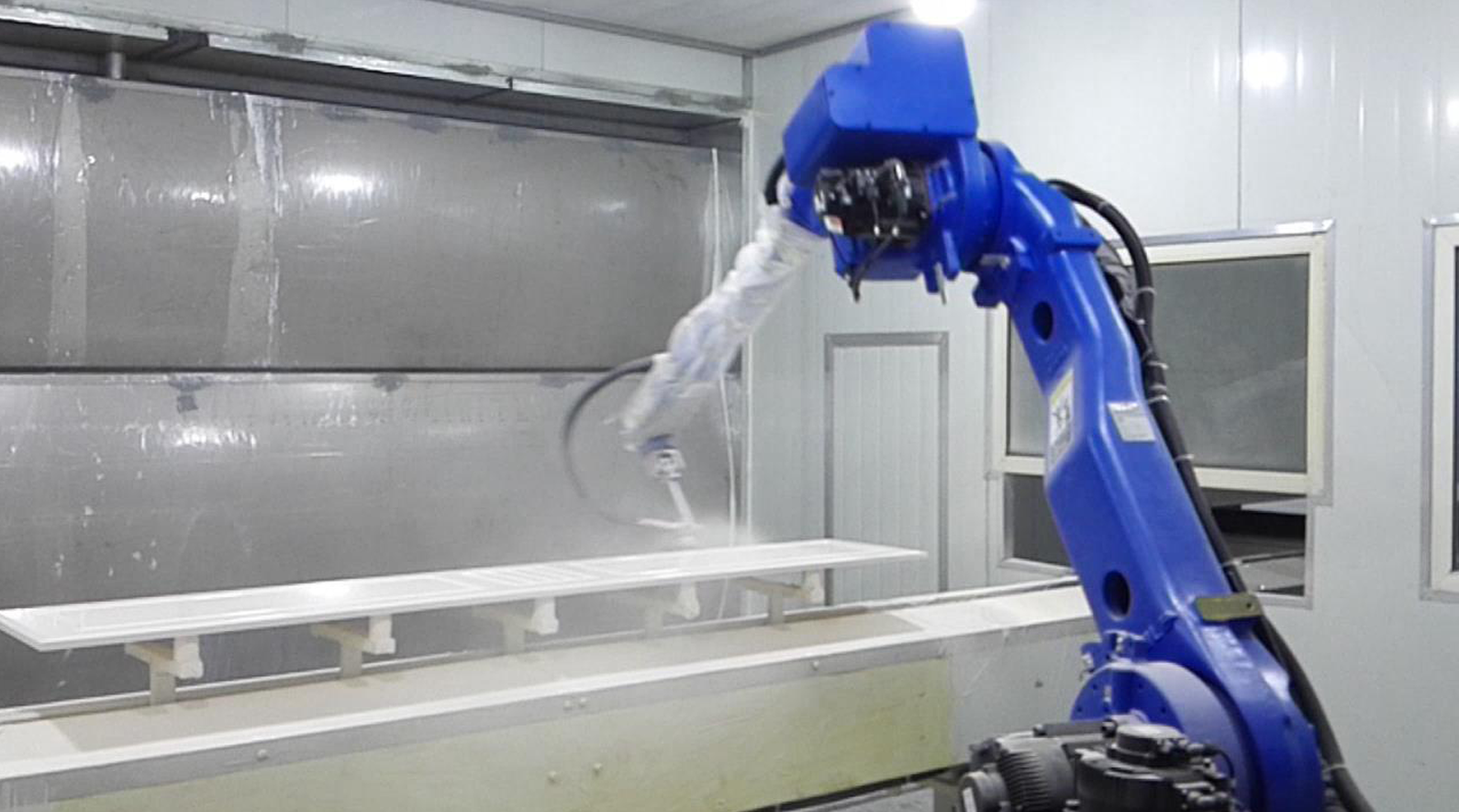 Automatic robot spray painting line of furniture.