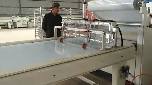 Automatic laminating and cutting protective film