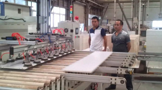 Automatic loading and unloading furniture board