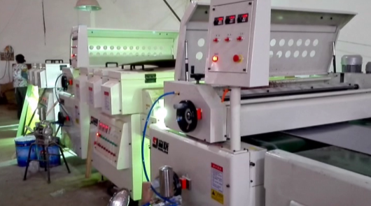 Automatic UV roller coating line of 3-ply fire ...